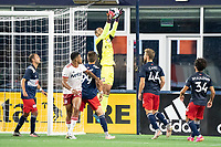 FOXBOROUGH, MA - JUNE 26: Earl Edwards Jr. #90 of the New England Revolution jumps to save a corner kick during a game between North Texas SC and New England Revolution II at Gillette Stadium on June 26, 2021 in Foxborough, Massachusetts.