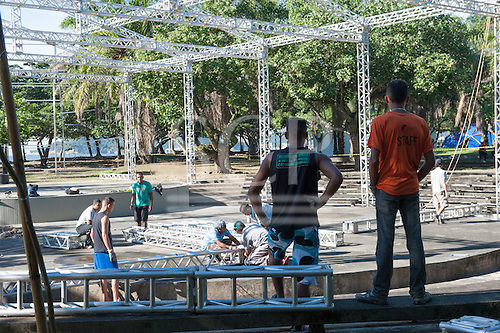 Workers are constructing a stage at the Aterro do Flamengo site of the People's Summit, the parallel civil society event which will take place during the Rio+20 event. Preparations have been delayed two days by heavy rain, which is unusual for this time of year. United Nations Conference on Sustainable Development (Rio+20), Rio de Janeiro, Brazil. Photo © Sue Cunningham.