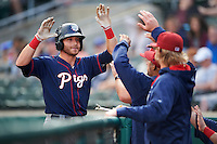 Lehigh Valley IronPigs third baseman Taylor Featherston (6) high fives teammates after hitting a home run during a game against the Buffalo Bisons on July 9, 2016 at Coca-Cola Field in Buffalo, New York.  Lehigh Valley defeated Buffalo 9-1 in a rain shortened game.  (Mike Janes/Four Seam Images)