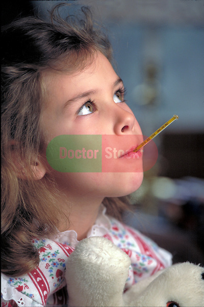 young girl with fever, thermometer in mouth looking ill