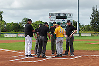 Siena Saints head coach Tony Rossi (40) during the lineup exchange with Pittsburgh Panthers head coach Joe Jordan (jacket) before a game on February 24, 2017 at Historic Dodgertown in Vero Beach, Florida.  Pittsburgh defeated Siena 8-2.  (Mike Janes/Four Seam Images)