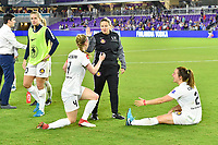 Orlando, FL - Saturday March 24, 2018: Utah Royals head coach Laura Harvey gives a high-five to Utah Royals defender Becky Sauerbrunn (4) while Utah Royals defender Rachel Corsie (2) watches after a regular season National Women's Soccer League (NWSL) match between the Orlando Pride and the Utah Royals FC at Orlando City Stadium. The game ended in a 1-1 draw.