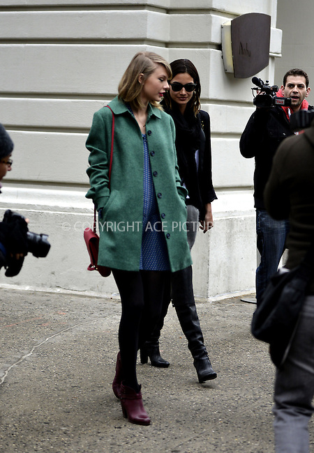 WWW.ACEPIXS.COM<br /> <br /> March 28 2014, New York City<br /> <br /> Taylor Swift (L) and Lily Aldridge walk back to Swift's Tribeca apartment on March 28 2014 in New York City<br /> <br /> By Line: Curtis Means/ACE Pictures<br /> <br /> <br /> ACE Pictures, Inc.<br /> tel: 646 769 0430<br /> Email: info@acepixs.com<br /> www.acepixs.com