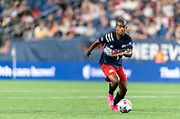 FOXBOROUGH, MA - JULY 7: Maciel #13 of New England Revolution brings the ball forward during a game between Toronto FC and New England Revolution at Gillette Stadium on July 7, 2021 in Foxborough, Massachusetts.