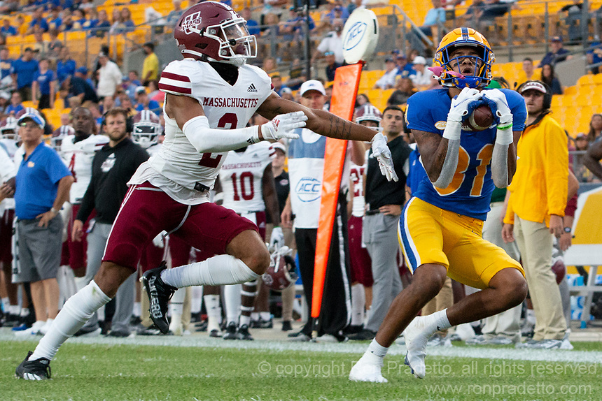 Pitt wide receiver Jaden Bradley makes a catch while being defended by UMass defensive back Bryce Watts (2). The Pitt Panthers defeated the UMass Minutemen 51-7 on September 4, 2021 at Heinz Field, Pittsburgh, PA.