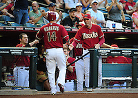 Jun. 6, 2012; Phoenix, AZ, USA; Arizona Diamondbacks third baseman Ryan Roberts (left) is congratulated by manager Kirk Gibson after scoring in the first inning against the Colorado Rockies at Chase Field.  Mandatory Credit: Mark J. Rebilas-