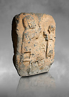Hittite monumental relief sculpture. Late Hittite Period - 900-700 BC. Adana Archaeology Museum, Turkey. Against a grey art background
