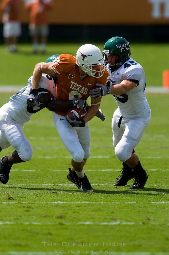 02 September 2006: University of Texas receiver Jordan Shipley breaks through two University of North Texas defenders during the Longhorns 56-7 victory over the Eagles at Darrell K Royal Stadium in Austin, TX.