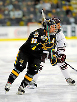 2 January 2009: University of Vermont Catamounts' forward Corey Carlson, a Senior from Two Harbors, MN, in action against the Colgate Raiders during the second game of the 2009 Catamount Cup Ice Hockey Tournament hosted by the University of Vermont at Gutterson Fieldhouse in Burlington, Vermont. The Catamounts defeated the Raiders 6-4 to move onto the championship game against the St. Lawrence Saints...Mandatory Photo Credit: Ed Wolfstein Photo