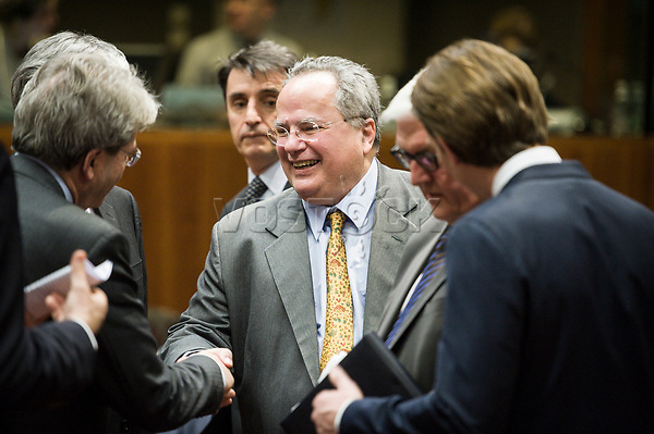 Greek Foreign Minister Nikos Kotzias is welcomed by the counterpart ministers  prior to the European Union Foreign Ministers Council at EU headquarters  in Brussels, Belgium on 29.01.2015 Federica Mogherini , EU High representative for foreign policy called extraordinary meeting on the situation in Ukraine after the attack on Marioupol.  by Wiktor Dabkowski