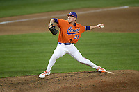 Pitcher Geoffrey Gilbert (31) of the Clemson Tigers delivers a pitch in a game against the Stony Brook Seawolves on Friday, February 21, 2020, at Doug Kingsmore Stadium in Clemson, South Carolina. Clemson won, 2-0. (Tom Priddy/Four Seam Images)