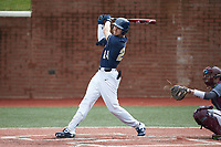 Ricky Clark (24) of the Wingate Bulldogs follows through on his swing against the Concord Mountain Lions at Ron Christopher Stadium on February 1, 2020 in Wingate, North Carolina. The Bulldogs defeated the Mountain Lions 8-0 in game one of a doubleheader. (Brian Westerholt/Four Seam Images)