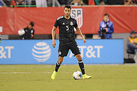 EAST RUTHERFORD, NJ - SEPTEMBER 7: Diego Reyes #5 of Mexico kicks the ball during a game between Mexico and USMNT at MetLife Stadium on September 6, 2019 in East Rutherford, New Jersey.
