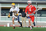 Baltimore, MD - March 3:  Midfielder Colin McLinden #4 of the Fairfield Stags moves up field with the ball against Midfielder Will Fejes #23 of the UMBC Retrievers during the Fairfield v UMBC mens lacrosse game at UMBC Stadium on March 3, 2012 in Baltimore, MD.