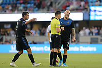 SAN JOSE, CA - AUGUST 24:  Referee Ramy Touchan  books Magnus Eriksson of the San Jose Earthquakes during a Major League Soccer (MLS) match between the San Jose Earthquakes and the Vancouver Whitecaps FC  on August 24, 2019 at Avaya Stadium in San Jose, California.