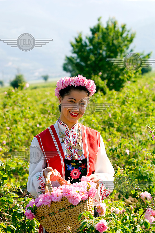 Portrait of a girl in traditional dress holding a basket of roses in the Festival of the Roses.