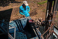 A Salvadoran farm worker controls the indigo processing while water solution is slowly siphoning out from a concrete tank at the semi-industrial manufacture near San Miguel, El Salvador, 12 November 2016. For centuries, indigo, a natural deep blue dye extracted from the leaves of tropical plants (Indigofera), has been known to the native indigenous inhabitants of Central America who used the blue tincture to color their fabrics and pottery. Although demand for natural indigo dropped significantly at the end of 19th century when a synthetic indigo was firstly introduced, commercialization of natural indigo has risen again during the last decades. Small-scale indigo farms, processing the crop on sustainable and ecological basis, are growing throughout the country, returning El Salvador to the place of the main natural indigo producer in Latin America.