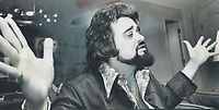 Celebrated Dis Jockey Wolfman Jack (real name Bob Smith from Brooklyn) extols working conditions in Toronto where he has joined with the CBC to produce an hour-long TV special which will lead into weekly half-hour series. He has become worldfamous through U.S. Armed Forces Radio Network.