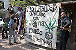 "Youths hold a banner that reads: ""For legalization, a world with marijuana is possible"", as they attend a rally demanding decriminalization of drug posession after Mexican Congress approved a drug law on April 29 to legalize the possession of small quantities of drugs and mandate treatment for addicts, May 6, 2006 Mexican President Vicente Fox refused to sign a drug decriminalization bill on Wednesday. Photo by Javier Rodriguez"