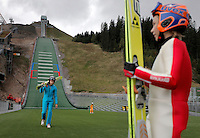 Young ski jumpers gather after a rare opportunity to try the new Midtstubakken ski jump. Starting out in smaller ski jumps in the forest nearby William  Kalfoss (right) wasn't even 14 when in Sept 2010 he got the opportunity   to try this ski jump hill which will be part of the World Ski Championships in skiing in 2011. .Midtstubakken is part of the Holmenkollen Ski Jump arena and has been rebuilt and upgraded to host the 2011 Championships. .In addition five smaller recruitment hills with year round facilities will be built, which ski jumping enthusiasts hope will make sure the Norwegian national sport will survive. .FIS Nordic World Ski Championships 2011 will take place in Oslo from 23 February to 6 March 2011.