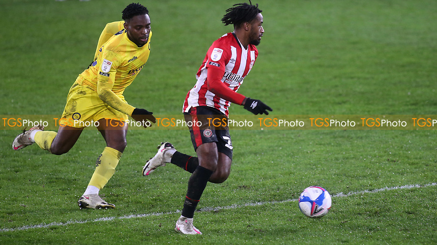 Brentford's Tariqe Fosu outpaces Wycombe's Fred Onyedinma during Brentford vs Wycombe Wanderers, Sky Bet EFL Championship Football at the Brentford Community Stadium on 30th January 2021