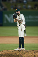 Greensboro Grasshoppers relief pitcher Austin Roberts (27) looks to his catcher for the sign against the Wilmington Blue Rocks at First National Bank Field on May 25, 2021 in Greensboro, North Carolina. (Brian Westerholt/Four Seam Images)