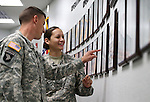 Nevada Army Guard Sgts. 1st Class Massimo Irenze and his wife Luciana look at the new tribute wall with the names of about 2,700 Nevada National Guard Soldiers and Airmen deployed into combat zones since Sept. 11, 2001, following a Nevada National Guard Combat Veterans Remembrance Day ceremony at the Office of the Adjutant General in Carson City, Nev., on Friday, April 17, 2015. <br /> Photo by Cathleen Allison