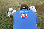 CHAD PILSTER •Hays Daily News<br /> <br /> Josh Waddell, a coach, runs a drill on Tuesday, September 10, 2013, during practice of the third grade Gamblers of the Hays Football Association  at Aubel-Bickle Park in Hays, Kansas.