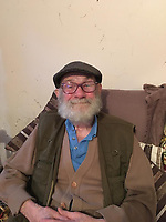 Pictured: Brian Owen<br /> Re: A cottage on the bank of the River Taff at Quaker's Yard, Merthyr Tydfil, was flooded out because of storm Dennis, forcing the 84 year old Brian Owen upstairs. Water levels went down at daylight leaving living room furniture bobbing around in brown sludge.