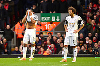 Sunday, 23 February 2014<br /> Pictured: Swansea City's Ashley Williams covers his face after Liverpool score their fourth goal<br /> Re: Barclay's Premier League, Liverpool FC v Swansea City FC v at Anfield Stadium, Liverpool Merseyside, UK.
