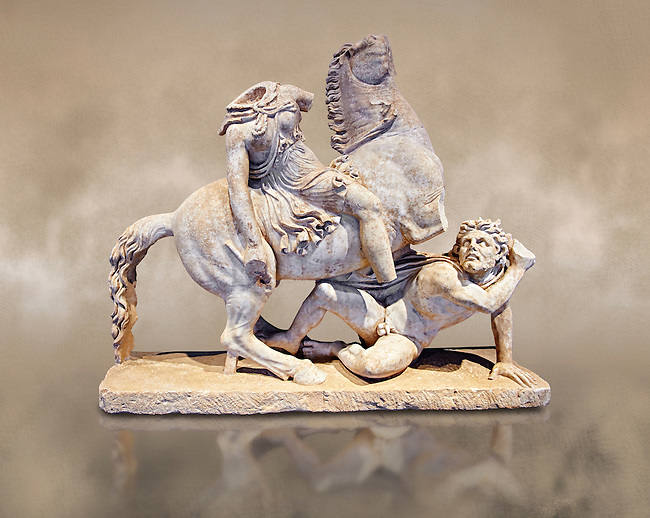 Roman Statue of an Amazon on horseback and a Barbarian, Circa mid 2nd cent AD excavated from the  Imperial villa near Faro, Italy. An Amazon perched on a rearing horse clashes with a barbarian who attempts to deal a final blow before dying. The work is based on a Hellenistic original from the Pergamon school from the second half of the 2nd cent. B.C, The group was displayed in the Imperial villa  with another of the same theme now in the Borghese collection. The National Roman Museum, Rome, Italy