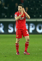 SWANSEA, WALES - MARCH 16: Joe Allen of Liverpool applauds away supporters after the Premier League match between Swansea City and Liverpool at the Liberty Stadium on March 16, 2015 in Swansea, Wales