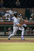 Salt River Rafters first baseman Josh Fuentes (19), of the Colorado Rockies organization, follows through on his swing during an Arizona Fall League game against the Scottsdale Scorpions at Scottsdale Stadium on October 12, 2018 in Scottsdale, Arizona. Scottsdale defeated Salt River 6-2. (Zachary Lucy/Four Seam Images)