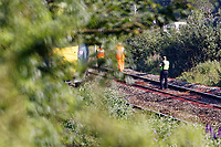 Pictured: Police by the stranded train on the tracks near Margam in south Wales, UK. Wednesday 03 July 2019<br /> Re: Two rail workers have died after being hit by a passenger train between Port Talbot Parkway and Bridgend stations in south Wales, UK.<br /> The pair were struck near Margam by the Swansea to London Paddington train at about 10am.<br /> They were pronounced dead at the scene and a third person was treated for shock, but was not injured.