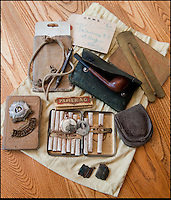 BNPS.co.uk (01202 558833)<br /> Pic: PhilYeomans/BNPS<br /> <br /> The suitcase even contained his bag of personnel effect's send back from the front in 1916.<br /> <br /> Discovered in a loft - Poingnant reminder of families tragic loss during the Great War.<br /> <br /> A moving time capsule containing the last belongings of a dead soldier his family couldn't bring themselves to look at has been found in an attic after 98 years.<br /> <br /> The possessions of Private Edward Ambrose were sent home from the Western Front to his devastated parents after he was killed at the Somme.<br /> <br /> Too painful to look at, the poignant items were shut into a leather case and put into storage where they remained for almost a century.<br /> <br /> The case has now been opened by Pvt Ambrose's 82-year-old nephew who recovered it after reading about an appeal for untold stories for a local First World War exhibition.<br /> <br /> The effects include black and white photos of his loved ones, letters from his parents, his half-smoked pipe and a cigarette case with 10 roll-ups.