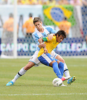 Brazil forward Neymar (11) shields the ball from Argentina defender Federico Fernandez (17) The Argentina National Team defeated Brazil 4-3 at MetLife Stadium, Saturday July 9 , 2012.