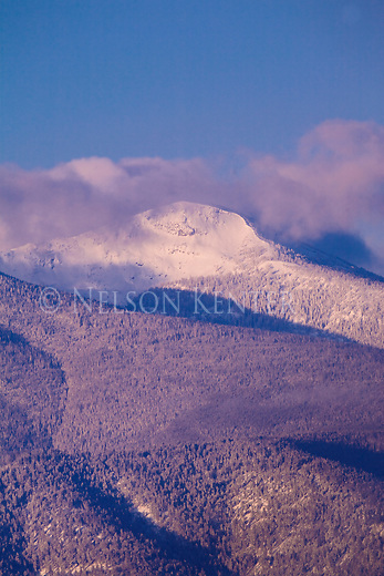 Low clouds hang over snow covered Lolo Peak outside of Missoula, Montana