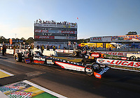 Aug 15, 2014; Brainerd, MN, USA; NHRA top fuel dragster driver Clay Millican (near lane) races alongside Terry McMillen during qualifying for the Lucas Oil Nationals at Brainerd International Raceway. Mandatory Credit: Mark J. Rebilas-