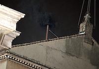 Fumo nero esce dal comignolo sul tetto della Cappella Sistina, Citta' del Vaticano, 12 marzo 2013. La fumata nera indica che il nuovo Papa della Chiesa Cattolica Romana non e' stato ancora eletto dai 115 cardinali del Conclave..Black smoke billows from the chimney atop the Sistine Chapel where 115 cardinals gathered to elect the new Pope of the Roman Catholic Church, at the Vatican, 12 March 2013. The black smoke indicates that the cardinals in the Conclave have not elected the new Pontiff..UPDATE IMAGES PRESS/Riccardo De Luca STRICTLY FOR EDITORIAL USE ONLY - STRICTLY FOR EDITORIAL USE ONLY