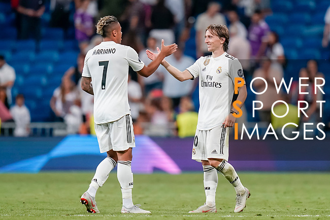 Luka Modric of Real Madrid (R) celebrates with Mariano Diaz Mejia of Real Madrid (L) after winning the UEFA Champions League 2018-19 match against Roma at Estadio Santiago Bernabeu on September 19 2018 in Madrid, Spain. Photo by Diego Souto / Power Sport Images