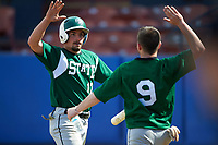 Farmingdale Rams left fielder Ryan Osborne (17) high fives Joshua Shapiro (9) during a game against the Union Dutchmen on February 21, 2016 at Chain of Lakes Stadium in Winter Haven, Florida.  Farmingdale defeated Union 17-5.  (Mike Janes/Four Seam Images)