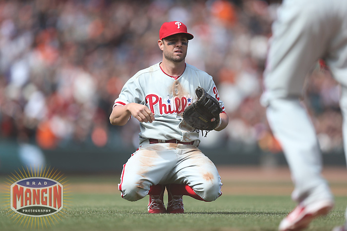 SAN FRANCISCO, CA - MAY 8:  Kevin Frandsen #28 of the Philadelphia Phillies kneels on the field during the game against the San Francisco Giants at AT&T Park on Wednesday, May 8, 2013 in San Francisco, California. Photo by Brad Mangin