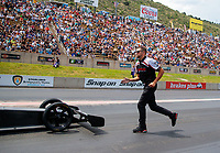 Jul 21, 2019; Morrison, CO, USA; Crew member Gary Pritchett for NHRA top fuel driver Steve Torrence during the Mile High Nationals at Bandimere Speedway. Mandatory Credit: Mark J. Rebilas-USA TODAY Sports