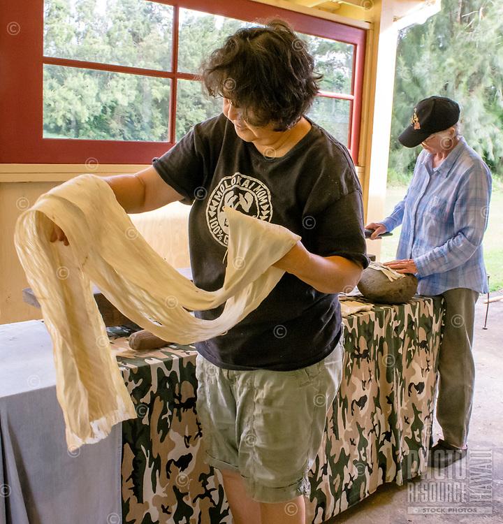 Kapa making on the Big Island: Master kapa maker Roen Hufford and student Julia work with beaten wauke, on its way to becoming kapa.