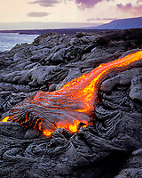 hot pahoehoe lava oozes from a breakout on a cooling field of lava from eruption of Pu'u O'o at Kilauea Volcano, Hawaii, USA Volcanoes National Park, Hawaii, USA Island, (Big Island), Hawaii, USA