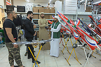 "United Arab Emirates (UAE). Dubai. Falcon & Heritage Sports Centre. The shop sells all equipment needed for falconry. An Emirati man explains to customers how to use a remote controlled airplane for training falcons. The man wears the traditional white thobe. A thawb (thobe, dishdasha, kandora) is an ankle-length garment, usually with long sleeves, similar to a robe, kaftan or tunic, commonly worn in the Arabian Peninsula. The headdress is called ghutrah. Falcons are birds of prey in the genus Falco, which includes about 40 species. Adult falcons have thin, tapered wings, which enable them to fly at high speed and change direction rapidly. Additionally, they have keen eyesight for detecting food at a distance or during flight, strong feet equipped with talons for grasping or killing prey, and powerful, curved beaks for tearing flesh. Falcons kill with their beaks, using a ""tooth"" on the side of their beaks. The United Arab Emirates (UAE) is a country in Western Asia at the northeast end of the Arabian Peninsula. 16.02.2020  © 2020 Didier Ruef"