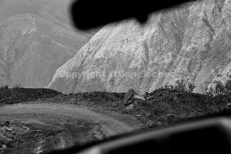 A sharp curve without any safety fence seen from a car going down the '24 curvas', a dangerous one-car-wide unpaved road, cut out of the rock, in Apurímac river canyon, Peru, 31 July 2012.