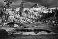 Small pond reflecting Eagle Cap Mountain. Eagle Cap wilderness, Oregon