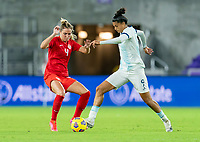 ORLANDO, FL - FEBRUARY 21: Shelina Zadorsky #4 of Canada defends Sole Jaimes #9 of Argentina during a game between Canada and Argentina at Exploria Stadium on February 21, 2021 in Orlando, Florida.