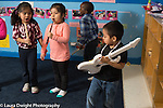 Education Preschool 4 year olds pretend play musical band group of girls and a boy making music